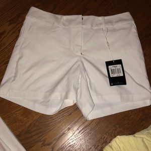 White golf shorts